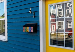 Jellybean Row Reflections (Karen_Chappell) Tags: stjohns jellybeanrow house window door blue yellow downtown city urban home rowhouse reflection reflections newfoundland nfld canada eastcoast avalonpeninsula atlanticcanada architecture wood wooden paint painted clapboard number mail post mailbox 41 red orange green colours color colour colors colourful canonef24105mmf4lisusm