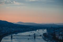 Sunset in Budapest (Nika Watson) Tags: hungary budapest bridge sunset hill evening blue pink canon landscape building water