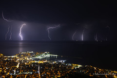Summer thunderstorm (Mavroudakis Fotis) Tags: energy lightning thunderstorm thunder city cityscape sky power electricity clouds night weather rain storm europe greece kavala mediterranean vivid awe urban ominous flash atmosphere building cloudy cloudscape dangerous bright dark nature disharge