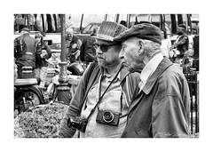 Chatting (PeteZab) Tags: bw blackandwhite people photographer conversation talking peterzabulis