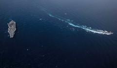 USS Ronald Reagan (CVN 76) sails alongside the JMSDF guided-missile destroyer JS Myoko (DDG-175). (Official U.S. Navy Imagery) Tags: masscommunicationspecialist2ndclasskailavpeters ussronaldreagan cvn76 forwarddeployedaircraftcarrier carrierstrikegroup5 maritime usnavy japan cfay commanderfleetactivitiesyokosuka yokosukaairpower seapower indopacific philippinesea