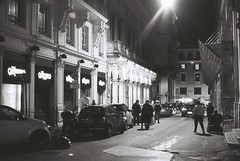 Roma (goodfella2459) Tags: nikonf4 afnikkor50mmf14dlens ilforddelta400 35mm blackandwhite film night analog city streets road buildings cars pedestrians roma italy rome light bwfp