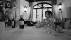 Of people, bottles and glasses (lebre.jaime) Tags: conceptual people gathering analogic film135 bw blackwhite noiretblanc nb pretobranco pb ilford xp2 iso400 contax g2 carlzeiss biogon 2828 epson v600 affinity affinityphoto ptbw