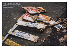 American Barricade (Doyle Wesley Walls) Tags: lagniappe 911 americanbarricade streetphotography color destruction text words signs deadleaves