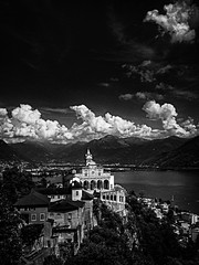 Madonna del Sasso, Locarno - Switzerland (Patrik S.) Tags: ngc sony a7m3 a7iii bw black white madonna del sasso tessin ticino switzerland sunny lage lago maggiore old history sanctuary monastry nature historic outside water sky sun light clouds landscape blackandwhite art noise panorama rock mountains hills summer locarno myswitzerland
