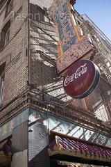 Low angle view, Coca Cola sign on China Town corner (jasonrosette) Tags: camerado jrosette jasonrosette streetscene sign california usa sanfrancisco china street streetphotography chinatown coca cola building