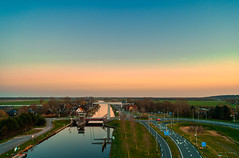 Schoorldammerbrug. (Alex-de-Haas) Tags: adobelightroom aurorahdr aurorahdr2019 dji dutch fc6310 hdr holland n9 nederland nederlands netherlands noordholland noordhollandschkanaal p4p phantom phantom4 phantom4pro rc schoorldam schoorldammerbrug skylum warmenhuizen westfrisia westfriesland aerial aerialphotography air beautiful beauty bridge brug canal drone dusk kanaal landscape landschaft landschap lente lucht luchtfotografie polder quadcopter reflectie reflection schemer schemering skies sky spring sundown sunset water zonsondergang schoorl northholland