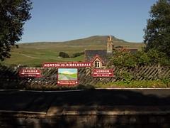 London 242 Miles (fraktalisman) Tags: yorkshire yorkshiredales settle carlise railway settlecarliserailway london sign red sky hill dales summer sunny afternoon britain england europe travel 2019