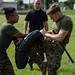 A Marine executes knee strikes after being sprayed by Oleoresin Capsicum Spray