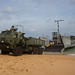 A landing craft, utility lowers its ramp to unload a High Mobility Artillery Rocket System