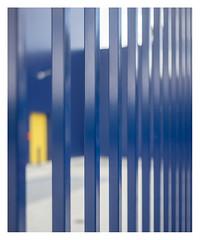 Yellow door (leo.roos) Tags: fence bokeh blau abstra colo2 geelblau colocomplem yellow blue geel blauw kerketuinen denhaag thehague allsafe mrboxcom a7 leidolfwetzlarlordonar12850 leidolf lordonar5028 1953 leidolflordomat rangefinder darosa leoroos