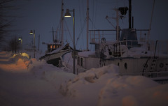Captain is staying up (Spotomy) Tags: winter boat harbour night snow dark lamplight suomi finland helsinki