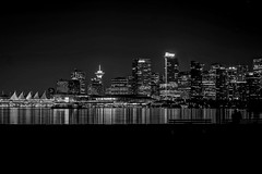 Skyline city (World-viewer) Tags: longexposure travel blackandwhite bw signs canada reflection water monochrome beautiful skyline architecture night vancouver skyscraper buildings prime lights reflecting mono evening amazing marine downtown nightlights bc skyscrapers minolta sony 28mm ngc award monotone explore stanleypark wander nationalgeographic skyrises primelens supershot a6000 ilce6000 outstanding