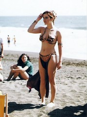 "Carrie Fisher from Rolling Stone's ""Star Wars Goes on Vacation"" photo shoot in 1983 (gameraboy) Tags: starwars 1983 1980s vintage slaveleia carriefisher cheesecake bikini goldbikini rollingstone"