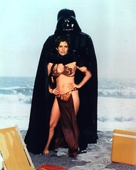 "Carrie Fisher and Darth Vader from Rolling Stone's ""Star Wars Goes on Vacation"" photo shoot in 1983 (gameraboy) Tags: starwars 1983 1980s vintage slaveleia carriefisher cheesecake bikini goldbikini darthvader rollingstone"