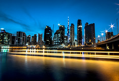 Dubaï at night (\Nicolas/) Tags: sunset dubai dubaï city united emirates arab bridge tower towers skyscrapper water canal long exposure burj khalifa business bay sun sky skyline calm golden hour khor night