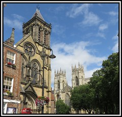 York. Catholic And Anglican (M E For Bees (Was Margaret Edge The Bee Girl)) Tags: york yorkshire northyorkshire church canon christianity churchofengland romancatholic tower clouds white sky blue stone old lamp towers windows summer sun trees