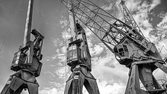 war of the worlds.. (claudi nir) Tags: hamburg harbour hafen historic cranes clouds absoluteblackandwhite monochrome sw sky bw blackwhite germany deutschland elbe industrie industrial