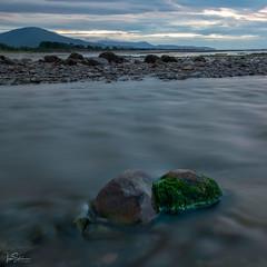 Beach Sunset number 3 (ivanstevensphotography) Tags: pebbles rocks seaside sea sky colour clouds seaweed stream sce sand scenery sunset