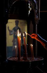 the hand that lightens the candels (daniel virella) Tags: thessaloniki greece candels light temple church religion flame devotion macedonia agiasofia θεσσαλονίκη unescoworldheritagesite