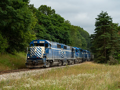 GLC train OSTN heads back northbound through the countryside just south of Cohoctah, Michigan with a 5 pack of EMD power pulling the train with ease, as 2 of the remaining venerable GP35's lead the way back to Owosso. (Chad Trepasso) Tags: trains glc railroads gp382 sd402 railfans gp35 greatlakescentral ostn cohoctahmichigan