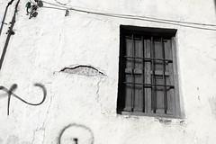 Linked to the past (Micheo) Tags: spain cerrillodemaracena viejo abandono derelict abandonado abandonedspain ventana window cables wires rejas bars pared pintadas pasado past