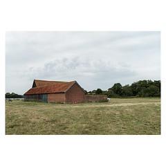 Old Barn (John Pettigrew) Tags: lines tamron d750 nikon historic old buildings rural clouds countryside hall imanoot angles ordinary sky mundane cars barn banal helmingham johnpettigrew field