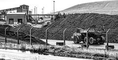Coal Plant (Peter Leigh50) Tags: mono monochrome high key blackandwhite coal mine dumper truck train track railway railroad rail industrial fujifilm fuji xt10 rain wet weather wales db cargo shed class 66 building factory