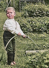 Fun with a hose pipe (theirhistory) Tags: child children kid boy trousers water wellies rubberboots garden plants