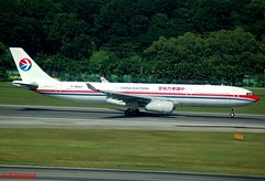 CHINA EASTERN A330 B-6507 (Adrian.Kissane) Tags: jet plane airline airliner aircraft airbus aeroplane trees airport runway grass outdoors 942 b6507 20122008 a330 singapore chinaeastern