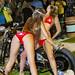 Sexy Girls in red bikini from Moulin Rouge cabaret on custom big bike. Phuket Bike Week, Thailand        XOKA1880bs