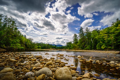 Summer afternoon on the Saco River (FotoFloridian) Tags: beautyinnature cloudsky forest mountain newhampshire outdoors reflection river rockobject rokinon saco scenics sony stoneobject stream summer travel tree whitemountains a6400 alpha landscape nature sky water