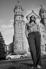 Kayla-68 (TheseusPhoto) Tags: girl female woman eyes pose goldenhour sunset face beautiful sexy glamour artportrait artphoto fineartportrait fineart portrait portraiture model modeling bnw blackandwhite blancoynegro monochrome cathedral church pants