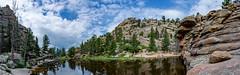 panoramic view of Gem Lake (Pejasar) Tags: gemlake pano panorama rock water lake mountains rockymountainnationalpark colorado hikers trees reflection
