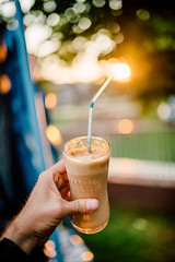 A young man holding a glass of iced coffee at home at sundown. Happy hour non-alcoholic beverage (Ivan Radic) Tags: eiskaffee fresh frozen afterwork alkoholfreiegetränke anonymous athome beautiful brown cafe caffeinemcappucino chocolate coffee cold condenstationcool cream cute delicious dessert drink entspannen espresso food frappe frappuccino glasses happyhour homemade iceicecube iced kalterkaffee lattee lifestyle macchiato milk mocha nachderarbeit nonalcoholicbeverage refreshment relaxing served sugar summer sunlightsummer sunset sweet nikond610 sigma35mmf14dghsmart ivanradic