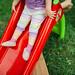 A toddler sliding down a slide
