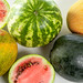 Fresh ripe watermelons and melons, top view