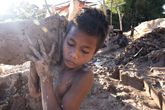 Aspiration (photo 2/24) (Mio Cade) Tags: work labor mud boy child documentary asia oppression flood education childlabor reportage
