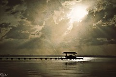 Sunsets and Silhouettes (paulgarf53) Tags: sunset silhouette boat boathouse river saintjohnsriver florida topazlabs art drama texture