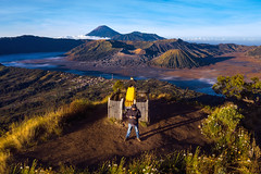 photographer on the top of mountain to take a sunrise photo by drone for Bromo vocano (anekphoto) Tags: trek adventure blue mt travel holiday outdoor park nature indonesia top high sunrise drone camera sunshine eruption volcano java morning sun aerial misty mist tourist man asia surabaya tourism viewpoint fog mountain mount landscape bromo sky view crater smoke active bromomountain scenic hiking national activevolcano background hill green beautiful cloud