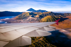 Airplane fly from surabaya and fly over indonesia (I love landscape) Tags: tourism travel destination fly wing speed flight plane skyline airport transportation asian asia bali surabaya java indonesia high view volcano mountain bromo wind landscape window paradise sunset airplane light dream blue cloudy heaven many climate smoke clear change nature storm sky over soft flow win stratosphere vacation typhoon season weather