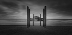 Broken but still standing... (Aleem Yousaf) Tags: brighton west pier lee graduated filter neutral density photo walk photography monochrome black white wide angle 1835mm long exposure outdoor south east united kingdom beach burnt out pebbles nikon nikkor d850 digital camera world flickr fire destruction birch trust channel english remains soft waterfront glory summer days august columns shell post broken standing left overcast gloom sky clouds