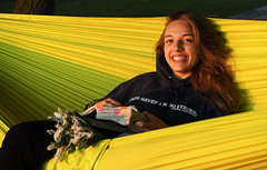 Quiet Time In a Hammock (Anthony Mark Images) Tags: sunset goldenhour yellowhammock yellow smile happy staff hoodie prettygirl lovely blueeys blondehair quiettime bible people portrait nikon d850 flickrclick summercamp fairhavens reflecting reading biblereading alexis charming younglady youth