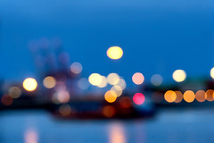 Ship in a harbor (Geolilli) Tags: blur bokeh ship harbor boat hamburg lights focus crane bay hamburger hafen canal fujifilm fuji xt20 strandperle strand perle harbour