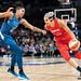 Elena Delle Donne (with the ball) guarded by Damiris Dantas
