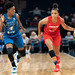 Natasha Cloud (with the ball) guarded by Danielle Robinson
