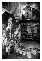 A quiet corner in the shopping centre (leo.roos) Tags: straatkunst streetart mural muurschildering wallart muralism kijkduin winkelcentrum shoppingmall shoppingcentre sloop demolition graffiti thsa thehaguestreetart noiretblanc bw sonye graffi muur a7 schneiderkreuznach robot m26 xenon schneiderkreuznachxenon4019 1943 darosa leoroos streetartcity winkelpromenadekijkduin
