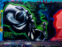 Remember to Wear a Mask (Steve Taylor (Photography)) Tags: aerosol spraycan doppel sniffing fumes alien graffiti cartoon mural streetart tag black blue green contrast red white spray paint glow outline