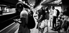 Underground (B Hutchison) Tags: xt1 fujifilm xf35mm bw blackandwhite underground subway metro phones