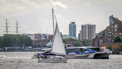 Yacht being overtaken by the riverboat (godrick) Tags: england london europe unitedkingdom greenwich gb riverthames olympianway yacht catamaran riverboat clipper